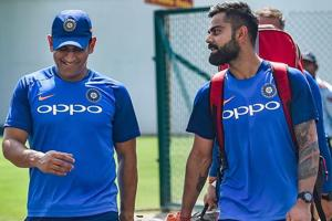 Virat Kohli and MS Dhoni (L) during a practice session ahead of the 2nd ODI against Australia.