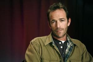 In this January 26, 2011 file photo, actor Luke Perry poses for a portrait in New York. Perry, who gained instant heartthrob status as wealthy rebel Dylan McKay on Beverly Hills, 90210, died Monday, March 4, 2019, after suffering a massive stroke, his publicist said. He was 52.