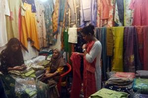 Buyers picking the Pakistani designers cloths at stall during the Holi mela organized by Bihar Mahila Udhyog Sangh Patna at Indira Gandhi Science Auditorium in Patna, India, on Monday