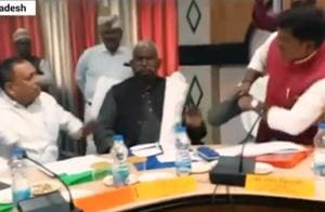 Screengrab of the video showing BJP MP Sharad Tripathi and party MLA Rakesh Singh Baghel exchanging blows at a meeting in Uttar Pradesh's Sant Kabir Nagar.