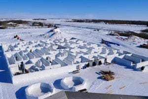People play in a maze built by farmers Clint and Angie Masse in St. Adolphe.