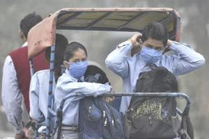 School going children wear masks to protect themselves from the toxic Delhi - NCR air.