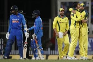 Australia players, right, celebrate their win in the third ODI between India and Australia in Ranchi.