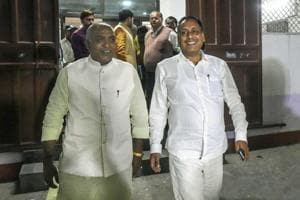 BJP MLA Rakesh Singh Baghel (right) comes out after meeting the party