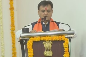 MLA Jawahar Chavda who resigned from Congress and joined BJP yesterday, takes oath as a minister in Gujarat government.