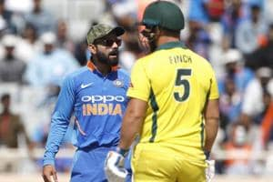 Virat Kohli, left, interacts with teammates before asking for a review for the wicket of Australia