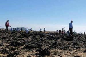 Rescue workers at the scene of the Ethiopian Airlines plane crash southeast of Addis Ababa on Sunday in which four Indians were among those killed.