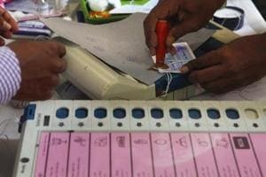 Election Commission staff seals Electronic Voting Machines (EVMs).