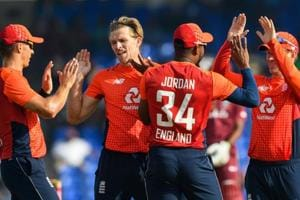 David Willey (2L), Chris Jordan (2R) and Eoin Morgan (R) of England celebrate the dismissal of Shimron Hetmyer of West Indies during the 3rd and final T20I between West Indies and England
