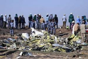 Ethiopian Federal policemen stand at the scene of the Ethiopian Airlines Flight ET 302 plane crash, near the town of Bishoftu, southeast of Addis Ababa, Ethiopia on March 11.