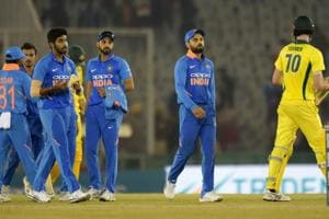 Indian skipper Virat Kohli along with teammates walk off the field after the fourth ODI against Australia.