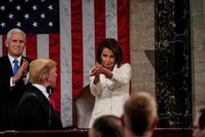 US president Donald Trump after the State of the Union address, with Vice President Mike Pence and Speaker of the House Nancy Pelosi, at the Capitol in Washington on February 5.