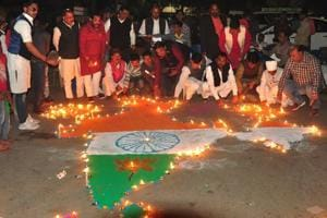 People light oil lamps to pay tribute to the martyrs of Pulwama terror attack and celebrate Indian Air Force