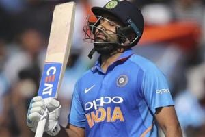Rohit Sharma raises his bat to celebrate scoring fifty runs during the fourth ODIagainst Australia.