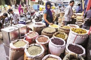A customer shops for pulses in a store at a local market in Hyderabad, India.