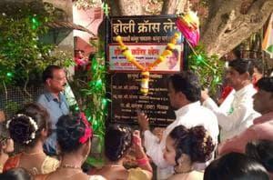 Residents celebrate the naming of the Holy Cross Lane in Kanjur gaothan on Sunday.