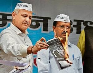 The Aam Aadmi Party (AAP), led by its national convener and Delhi chief minister Arvind Kejriwal, on Wednesday burnt the 2014 general election manifesto of the Bharatiya Janata Party (BJP) that promised full statehood to Delhi.