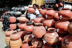 Water-pot vendors ready for business at Kumbharwada on Tuesday.