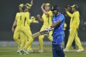 Kedar Jadhav walks back to the pavilion after his dismissal.