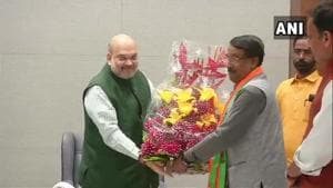 Congress leader Tom Vadakkan, who joined the BJP in New Delhi on Thursday,  with BJP president Amit Shah .