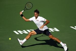 Roger Federer of Switzerland plays a forehand against Kyle Edmund at the Indian Wells.