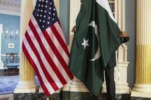A State Department contractor adjust a Pakistan national flag at the State Department in Washington.