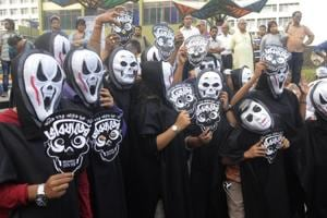People dress up as ghosts in a rally to protest against recently pulled out Bengali film 'Bhobishyoter Bhoot
