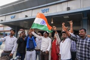 People in Mumbai celebrate India's air strike on a Pakistan-based terror camp, February 26