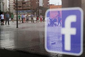Facebook logo is seen on a shop window in Malaga, Spain, June 4, 2018. REUTERS/Jon Nazca/Files