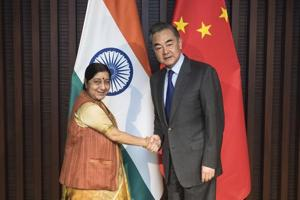 Afile photo of Xinhua News Agency, shows Chinese Foreign Minister Wang Yi, right, shakes hands with his Indian counterpart Sushma Swaraj at a meeting in Wuzhen Town, east China
