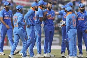 Mohammed Shami, centre, is congratulated by teammates after he dismissed Australia