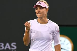 Angelique Kerber (GER) reacts at match point as she defeats Belinda Bencic (not pictured).