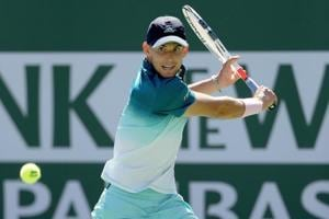 Dominic Thiem of Austria returns a shot to Milos Roanic at the Indian Wells Masters.