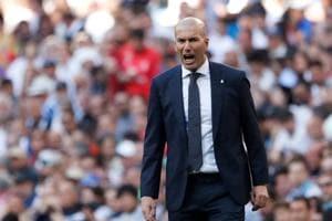 Real Madrid coach Zinedine Zidane reacts during their match against Celta Vigo on Saturday.