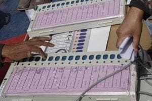 Polling officers check electronic voting machines (EVM) at an EVM distribution centre.