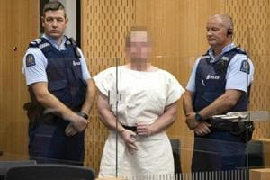 Brenton Tarrant, the man charged in relation to the Christchurch massacre, makes a sign to the camera during his appearance in the Christchurch District Court on March 16, 2019.