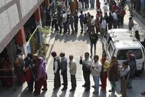 People waiting in a queue to cast their vote during the Delhi Assembly Elections in 2015.