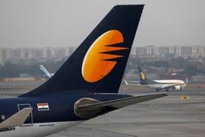 A Jet Airways plane is parked as another moves to runway at the Chhatrapati Shivaji International airport in Mumbai on February 14.