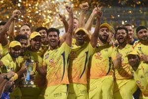 Chennai Super Kings players celebrate with the IPL 2018 trophy after winning the final match against Sunrisers Hyderabad.