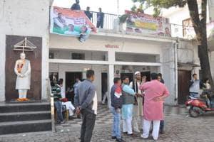 Congress workers outside the party headquarter,RajivBhawan, in  Dehradun.