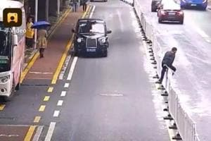 He tried to cross the road by climbing over the guardrails in the middle of the road.