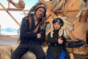 Shah Rukh Khan and AbRam can be seen sporting Native American headgears in a picture shared by Gauri Khan.