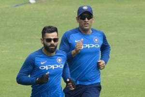 Indian captain Virat Kohli, left, with M S Dhoni, right warm up during a practice session ahead of the first one day international cricket match against Australia, in Hyderabad, India, Friday, March 1, 2019