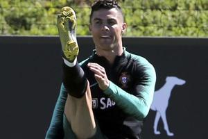 Cristiano Ronaldo stretches during a training session of the Portuguese soccer team in Oeiras.