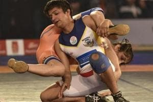 Ritu Phogat (white singlet) in action during the Pro Wrestling League final match.