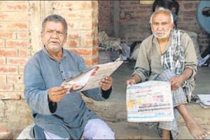 "In Gaya's Dumri, Mohammed Anwar (left) runs a small business and blames Narendra Modi for ""disrupting livelihoods""."