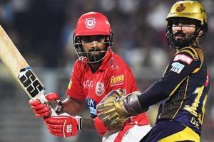 File image:Kings XI Punjab cricketer KL Rahul plays a shot as Kolkata Knight Riders captain Dinesh Karthik looks on.