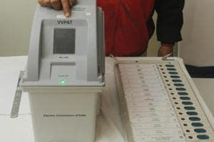 Patna, India - January 18, 2019: An electoral officer demonstrates the Electronic Voting Machine (EVM) and Voter Verifiable Paper Audit Trail (VVPAT) during the review meeting of poll preparedness of the state for the upcoming general elections, in Patna, Bihar, India, on Friday, January 18, 2019.