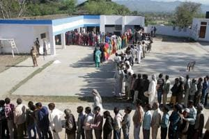 Voters stand in a queue to cast their votes at a polling station during parliamentary elections in Jammu, India, on Thursday, April 10, 2014. Millions of people are voting in the third phase of the elections Thursday, covering parts of 11 of India