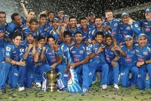 The Mumbai Indians celebrate after winning the IPL in 2013.